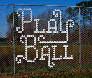 cup in fence baseball sign